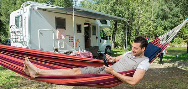 Man watching TV outside of camper